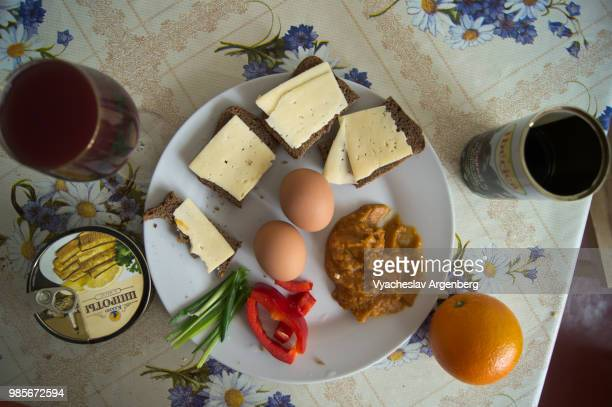 breakfast with eggs, wine, smoked sprats and cheese sandwiches - rostov on don stock pictures, royalty-free photos & images