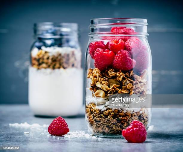 Breakfast with granola, berries, and yogurt in a jar