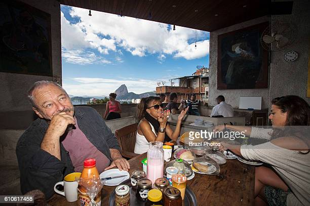 Breakfast with Maurice Nadkarni owner of The Maze jazz club and hostel on top of Tavares Bastos favela in Catete neighborhood Rio de Janeiro Brazil