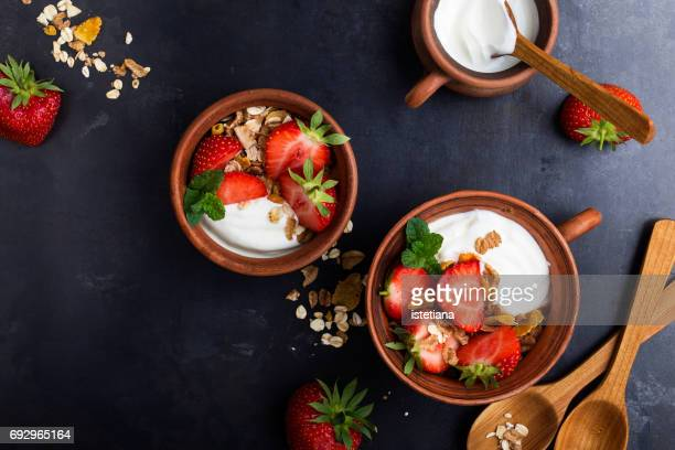 Breakfast with muesli, yogurt and fresh strawberries