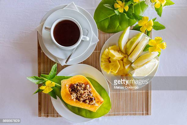 Breakfast with payapa, tropical fruit and coffee