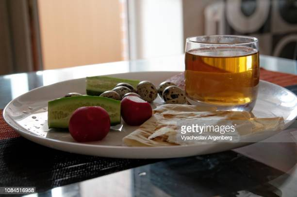 breakfast with peas, quail eggs, cucumber, pita and apple juice; extreme close-up - rostov on don stock pictures, royalty-free photos & images