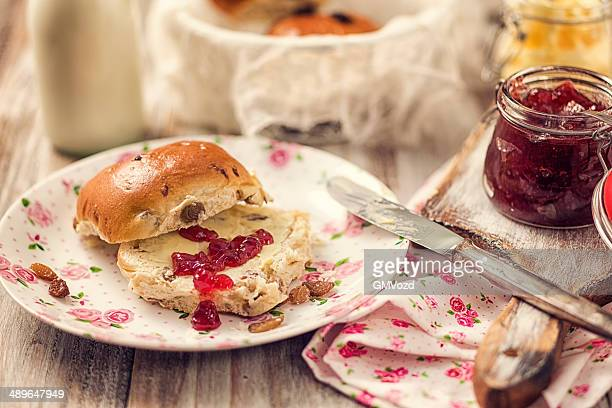 breakfast with raisin buns - hot cross bun stock pictures, royalty-free photos & images