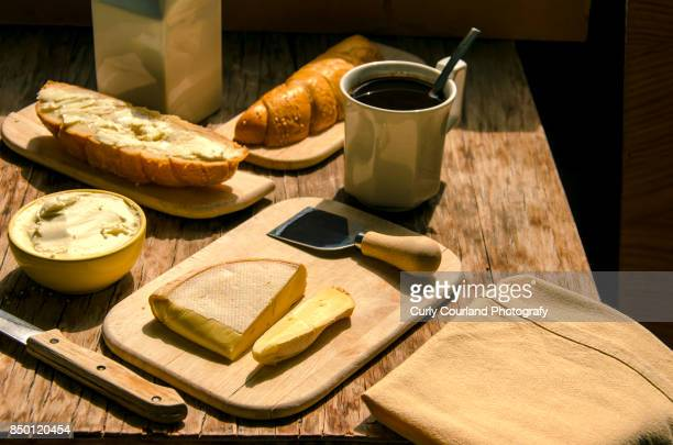 Breakfast with Reblochon French cheese, Ukranian artisanal goat milk butter, croissant and coffee.
