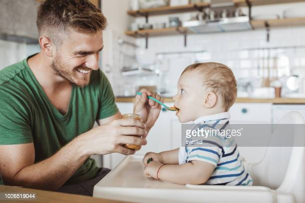 breakfast with son - feeding stock pictures, royalty-free photos & images