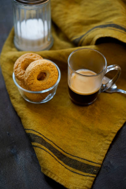 Breakfast with sugar-free wholemeal flour biscuits and organic coffee. Italy.