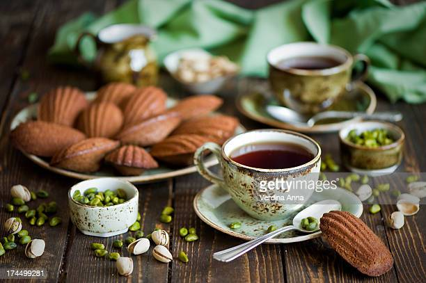 breakfast with tea and chocolate pistachio madelei - anna verdina stock photos and pictures