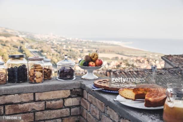 breakfast with typical local pastries in italy - marche italia foto e immagini stock