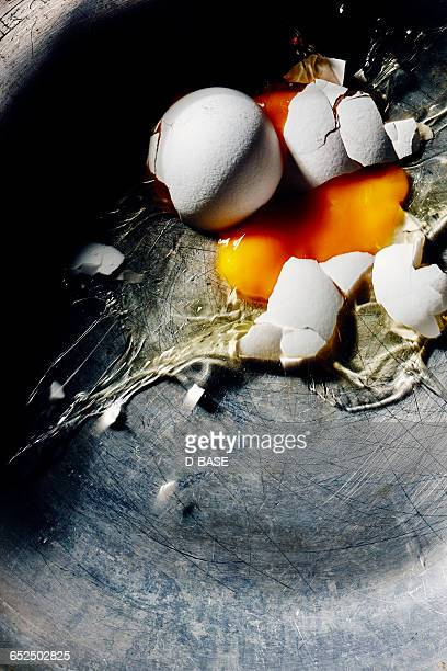 breaking egg on a pan