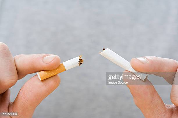 breaking the habit - cigarette stock pictures, royalty-free photos & images