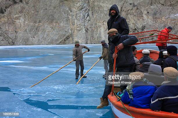Breaking the ice to sail away. Attabad Lake, Gojal, also known as Gojal Lake], is a lake in the Gojal Valley of northern Pakistan created in January...