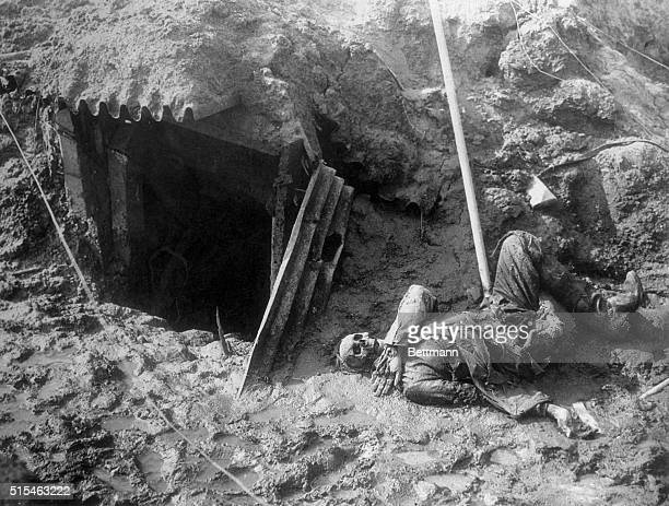 Breaking through the Hindenburg line in the Argonne, the Yanks found this abandoned trench and dugout with a lone skeleton staring at the sky from...