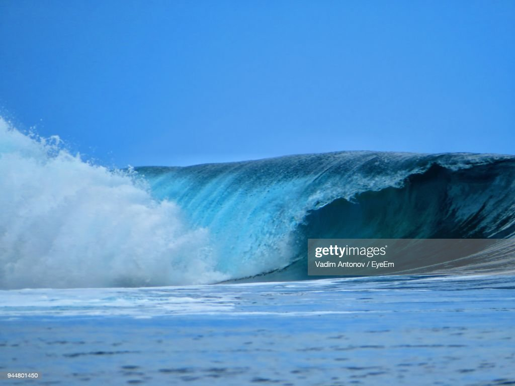 Breaking Wave At Sea Against Clear Blue Sky : Stock Photo