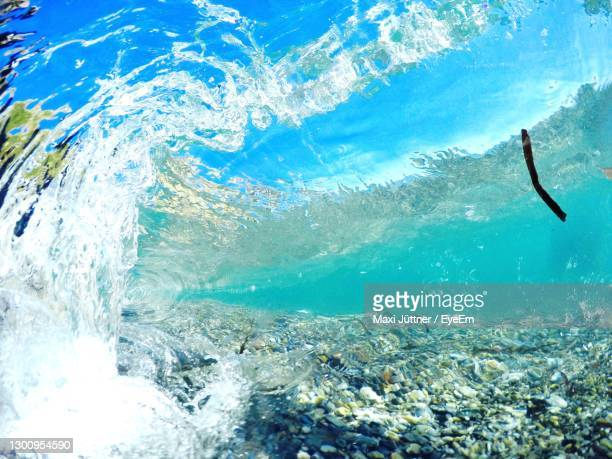 breaking wave - gabon stock pictures, royalty-free photos & images