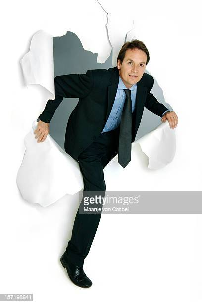 breakthrough businessman - caucasian appearance stock pictures, royalty-free photos & images