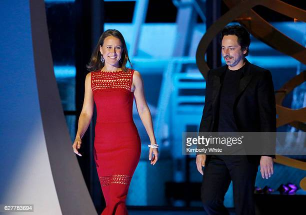 Breakthrough Prize CoFounders Anne Wojcicki and Sergey Brin speak onstage during the 2017 Breakthrough Prize at NASA Ames Research Center on December...