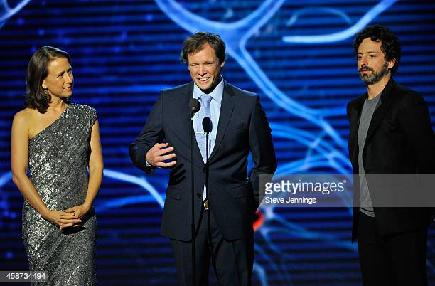 Breakthrough Prize Founders Anne Wojcicki and Sergey Brin and patient Nicolas Berben speak onstage during the Breakthrough Prize Awards Ceremony...