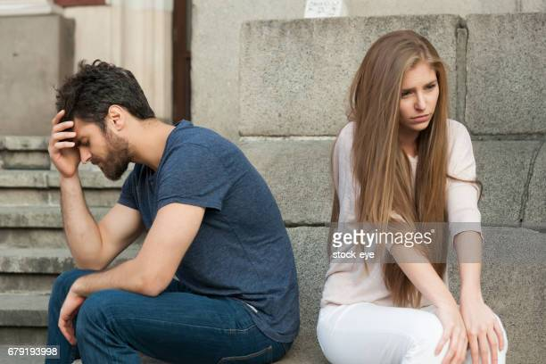 breakup of a couple with bad girl and sad boyfriend - dismissal stock photos and pictures