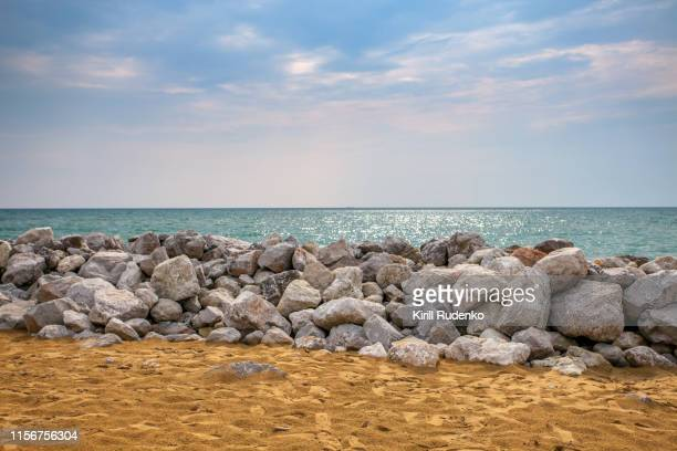 Breakwater at the beach in summer