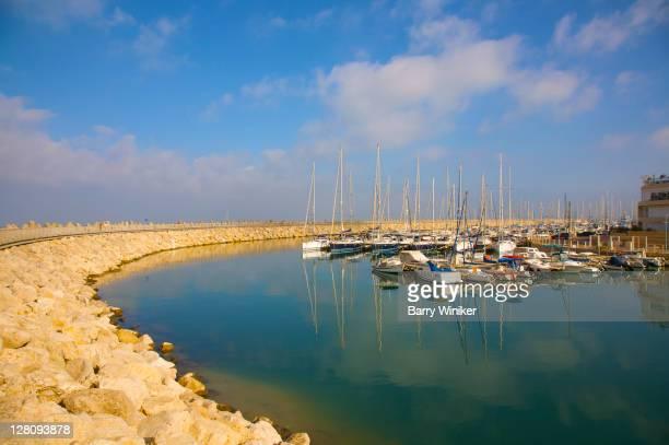 Breakwater with boats in marina at Herzliya, Israel