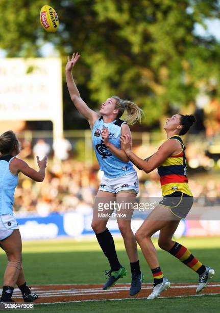 Breann Moody of Carlton and Rhiannon Metcalfe of the Adelaide Crows ruck a throw in during the round five AFLW match between the Adelaide Crows and...