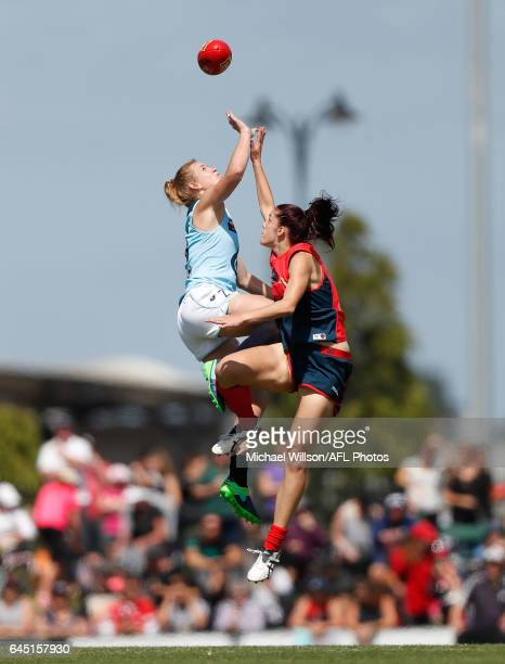 Breann Moody of the Blues and Lauren Pearce of the Demons compete in a ruck contest during the 2017 AFLW Round 04 match between the Melbourne Demons...