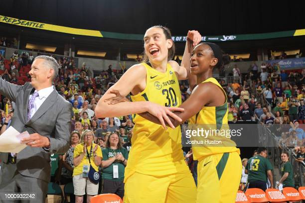 Breanna Stewart and Jewell Loyd of the Seattle Storm react during the game against the Dallas Wings on July 14 2018 at Key Arena in Seattle...