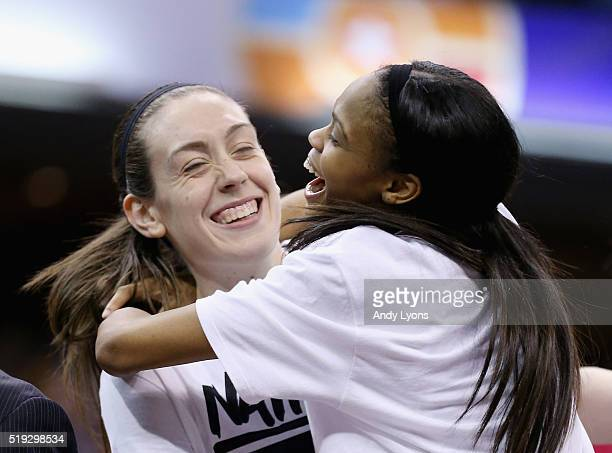 Breanna Stewart and Moriah Jefferson of the Connecticut Huskies celebrate during the trophy presentation after they defeated Syracuse Orange to win...