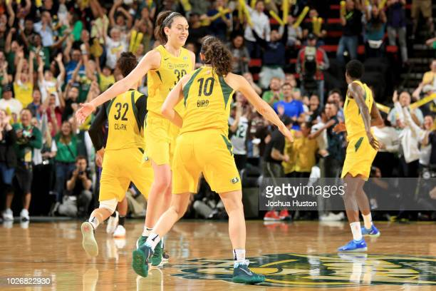 Breanna Stewart and Sue Bird of the Seattle Storm high five during the game against the Phoenix Mercury during Game Five of the 2018 WNBA Playoffs on...