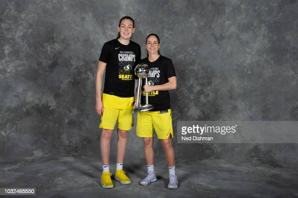 Breanna Stewart and Sue Bird of the Seattle Storm pose with the 2018 WNBA Championship trophy after defeating the Washington Mystics in Game Three of...