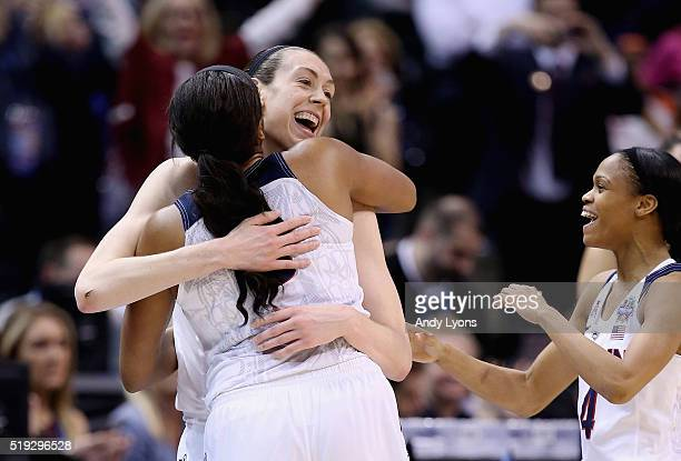 Breanna Stewart Morgan Tuck and Moriah Jefferson of the Connecticut Huskies embraces as the starters take the bench in the fourth quarter against the...
