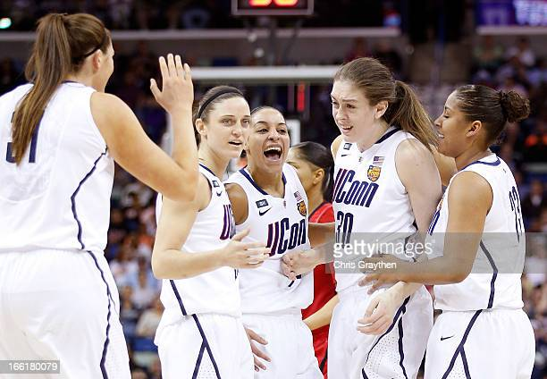 Breanna Stewart of the Connecticut Huskies celebrates with teammates after a play in the first half against the Louisville Cardinals during the 2013...