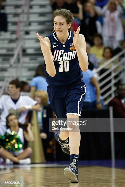 Breanna Stewart of the Connecticut Huskies reacts to a three point shot against the Notre Dame Fighting Irish during the National Semifinal game of...