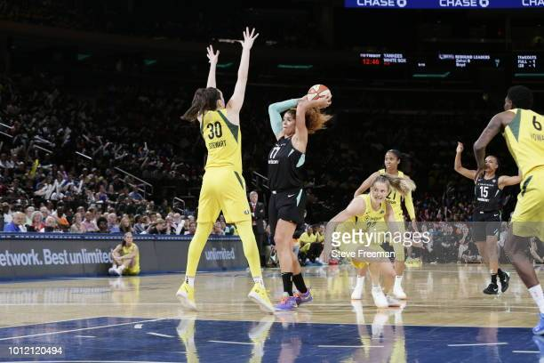 Breanna Stewart of the Seattle Storm attempts to block the shot of Amanda Zahui B #17 of the New York Liberty during a game played on August 6 2018...