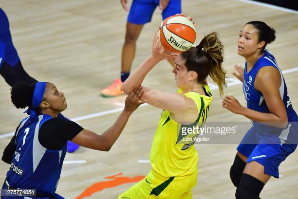 Breanna Stewart of the Seattle Storm controls the ball against Odyssey Sims of the Minnesota Lynx during the second half of Game One of their Third...