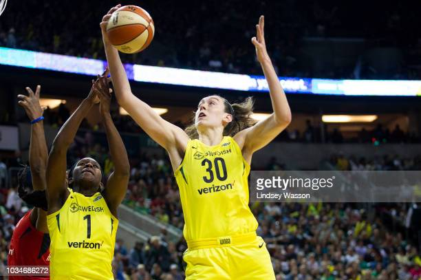 Breanna Stewart of the Seattle Storm grabs the rebound over teammate Crystal Langhorne against the Washington Mystics during the first half of Game 2...