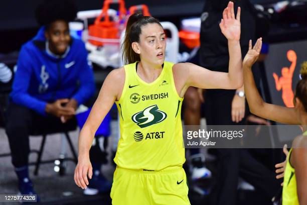 Breanna Stewart of the Seattle Storm high fives a teammate during the second half of Game One of their Third Round playoff against the Minnesota Lynx...