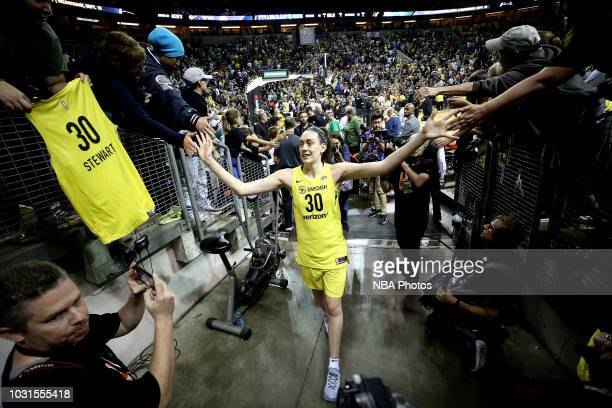 Breanna Stewart of the Seattle Storm highfives fans after the game against the Washington Mystics during Game Two of the 2018 WNBA Finals on...