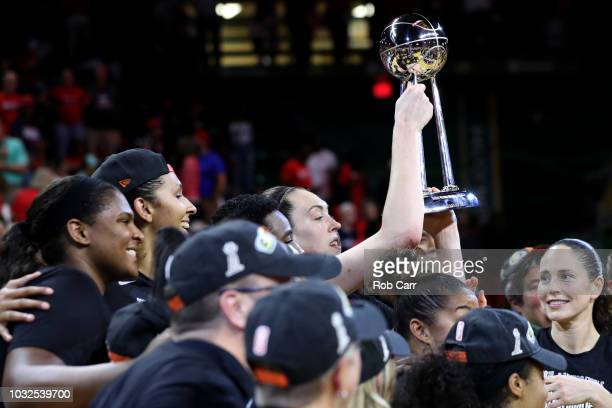 Breanna Stewart of the Seattle Storm holds up the trophy after the Storm defeated the Washington Mystics 9882 to win the WNBA Finals at EagleBank...