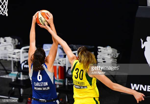 Breanna Stewart of the Seattle Storm knocks a ball out of bounds from Bridget Carleton of the Minnesota Lynx during the first half of Game One of...