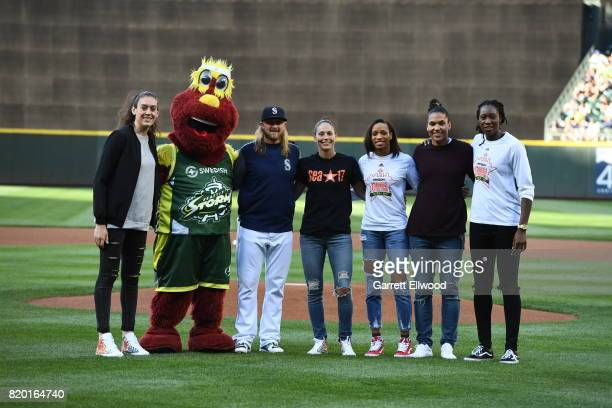 Breanna Stewart the Storm mascot Taylor Motter Sue Bird Jasmin Thomas Alyssa Thomas and Tina Charles pose for a photo before throwing out the first...