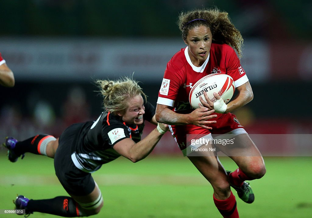 Breanne Nicholas of Canada is tackled by Fran Matthews of England during day one of the Emirates Dubai Rugby Sevens - HSBC World Rugby Women's Sevens Series on December 1, 2016 in Dubai, United Arab Emirates.
