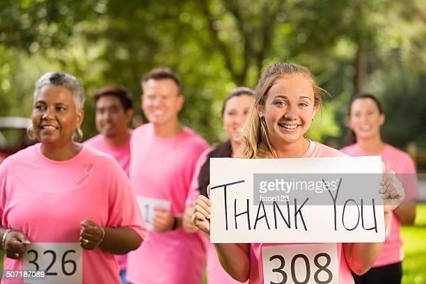 Breast Cancer Awareness volunteers run charity race.