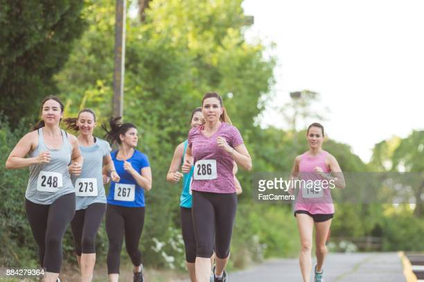 breast cancer fundraiser run - doing a favor stock pictures, royalty-free photos & images
