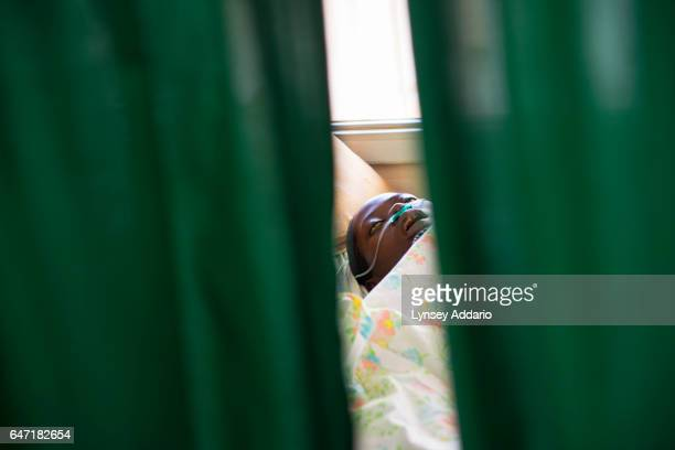 Breast Cancer patient Jolly Komurembe lies dying as her heart fails in the Solid Tumor Ward of the Cancer Institute attached to the Mulago Hospital...