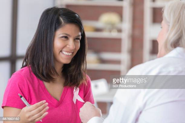 Breast cancer patient talks with doctor