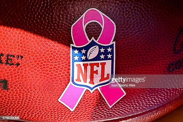 Breast Cancer Ribbon and NFL Shield on the football to be used in the game between the Denver Broncos and the New York Jets played at MetLife Stadium...