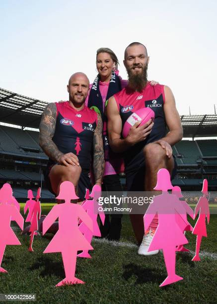Breast cancer survivor Jo Francis poses with Nathan Jones and Max Gawn of the Demons during the launch of the Field of Women at the Melbourne Cricket...
