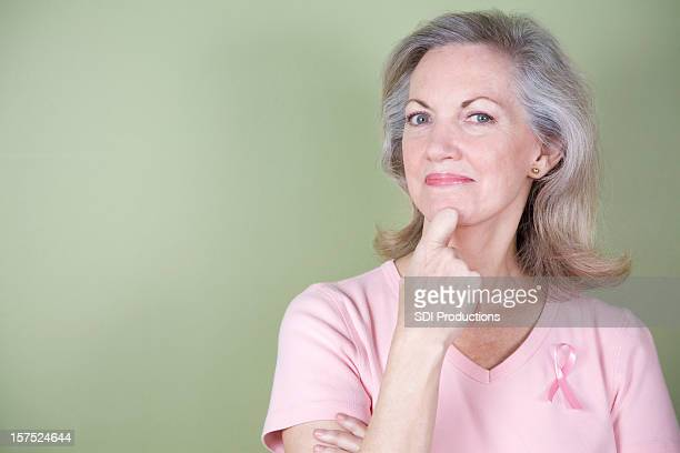 Breast Cancer Survivor with Pin and Hand to Chin