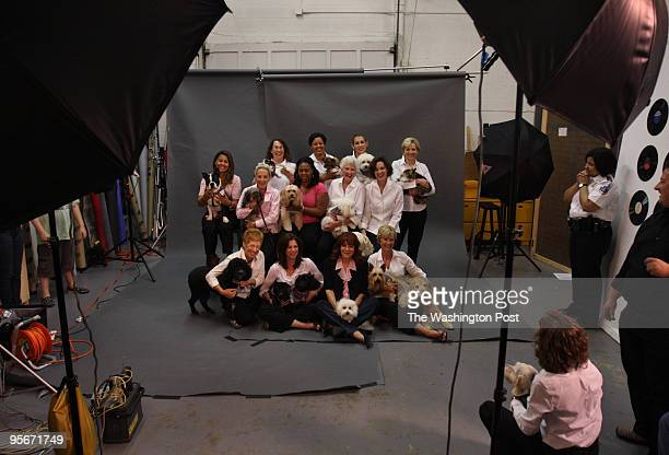 Breast cancer survivors have their portrait made during a calendar shoot at at Images X Photography Studio. Clancy Kress, president of the non-profit...